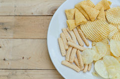 Mix snacks in dish on wood background Royalty Free Stock Photo