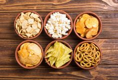 Mix of snacks. Frame . Mix of snacks : pretzels , crackers , chips nachos and pop corn stock photos