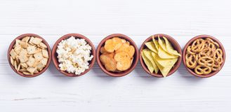 Mix of snacks. Frame . Mix of snacks : pretzels , crackers , chips nachos and pop corn royalty free stock image