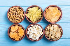 Mix of snacks. Frame . Mix of snacks : pretzels , crackers , chips nachos and pop corn royalty free stock images
