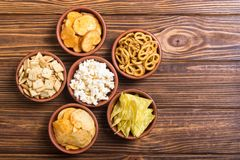 Mix of snacks. Frame . Mix of snacks : pretzels , crackers , chips nachos and pop corn stock photo