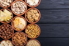 Mix of snacks. Pretzels , crackers , chips , nuts and nachos stock photos