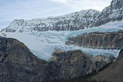 Glacier flowing down a mountain stock photos