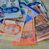 Mix some asia country money. Include Singapore indian Malaysia royalty free stock images