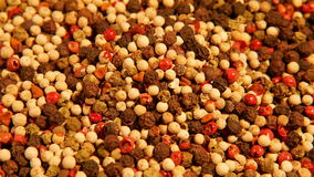 Mix of spices: red black white green hot pepper stock footage