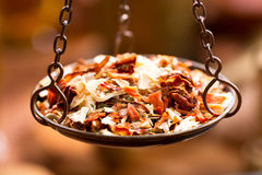 Mix of spices in vintage bowl weights Royalty Free Stock Images