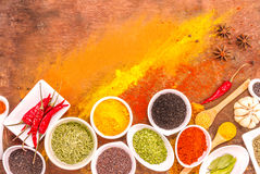 Mix spices on wood texture background. Stock Photos