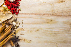 Mix spices on wood texture. Royalty Free Stock Photo