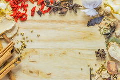 Mix spices on wood texture. Stock Images