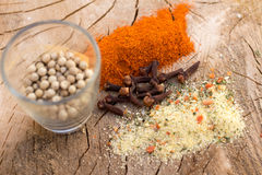 Mix of spices on wooden background Stock Images