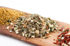 Mix of spices on wooden board Royalty Free Stock Photos