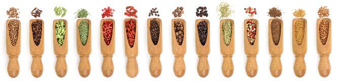 Mix of spices in wooden scoop isolated on a white background. Top view. Flat lay. Set or collection.  stock photography