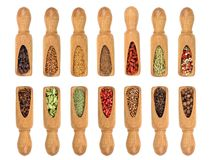 Mix of spices in wooden scoop on a white background. Top view. Flat lay. Set or collection.  royalty free stock images