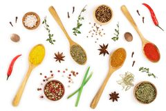 Mix of spices in wooden spoon isolated on a white background. Top view. Flat lay. Set or collection.  stock image