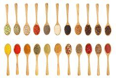 Mix of spices in wooden spoon isolated on a white background. Top view. Flat lay. Set or collection.  stock images