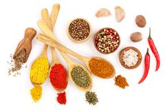 Mix of spices in wooden spoon isolated on a white background. Top view. Flat lay. Set or collection.  stock photo