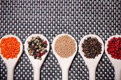 Mix of spicy ingredients for healthy cooking, pepper corns stock photo