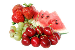 Mix of summer fruits. Strawberries, watermelon, cherries and gooseberries Royalty Free Stock Photo