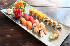 Mix sushi. On a plate stock photos