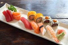 Mix sushi. On a plate stock images