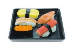 Mix sushi on black plate Stock Image