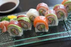 Mix sushi rolls, Japanese food. Mix sushi rolls on a glass plate stock images
