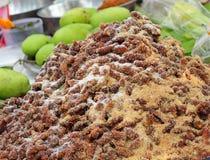 Mix tamarind put sugar ,salt, pepper at market Royalty Free Stock Images