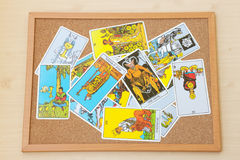 Mix of tarot cards on the cork board. Royalty Free Stock Photos