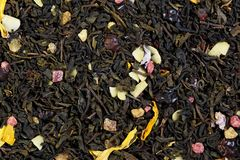 Mix tea from pineapple and almond flakes, mallow petals and sunf. Lower, rosehip peel Stock Photo