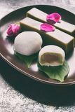Mix of Traditional Japanese sweets - daifuku mochi sweet paste anko wrapped around with soft rice mochi shell and jelly dessert. Yokan made of beans, agar stock image