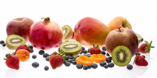 Mix Of Tropical And Nontropical Fruit On White Royalty Free Stock Photography