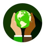 Mix of two different races holding hands globe. The concept of friendship among peoples and racial equality Stock Image