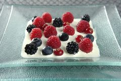 Mix of varied berries and cream. Dessert of mixed and varied berries and cream stock image