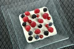 Mix of varied berries and cream Royalty Free Stock Photos