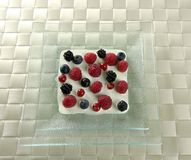 Mix of varied berries and cream Stock Photos