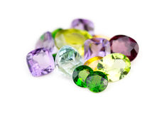 Mix of various natural Earth mined faceted gemstones. On white background Stock Photography