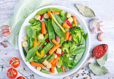 Mix vegetables. In bowl and on a table royalty free stock photos