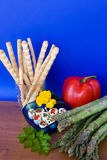 Mix Of Vegetables, Cheese And Breadsticks. Food & Drinks - Mediterranean diet: small pieces of seasoned cheese, breadsticks, asparagus and red pepper Royalty Free Stock Images