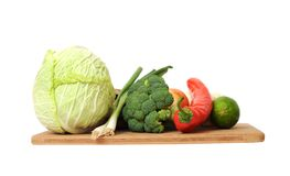 Mix vegetables. On cutting board isolated on white royalty free stock image