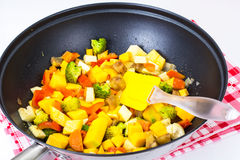 Mix vegetables, stewed in a pan  at home crocheted napkins on a Stock Photos
