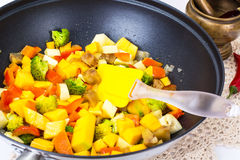 Mix vegetables, stewed in a pan  at home crocheted napkins on a Royalty Free Stock Photos