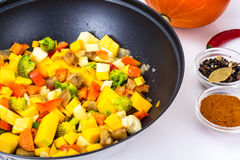 Mix vegetables, stewed in a pan  at home crocheted napkins on a Stock Photography