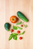 Mix of vegetables on wooden background - summer garden harvest. Stock Images