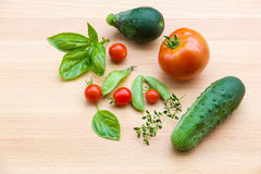 Mix of vegetables on wooden background - summer garden harvest. Royalty Free Stock Photo