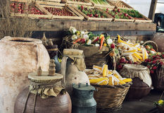 Mix of vegetables in wooden containers and wicker baskets with c Stock Photo