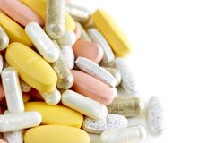 Mix of vitamins. And herbal supplements on white background Royalty Free Stock Photos