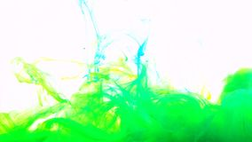 Mix yellow and blue color paint ink drops in water slow motion full hd video white background with copy space. Inky cloud swirling flowing underwater. Abstract stock video footage