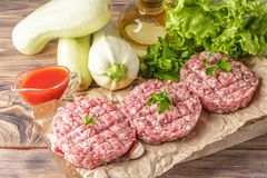 Mixe of ground meat minced beef and pork. Mixe of ground meat cutlets minced beef and pork Set for cooking barbecue steaks kebabs sausages fried on fire Food Royalty Free Stock Photography