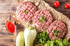 Mixe of ground meat minced beef and pork. Mixe of ground meat cutlets minced beef and pork Set for cooking barbecue steaks kebabs sausages fried on fire Food Stock Images
