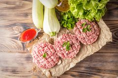 Mixe of ground meat minced beef and pork. Mixe of ground meat cutlets minced beef and pork Set for cooking barbecue steaks kebabs sausages fried on fire Food Royalty Free Stock Photos